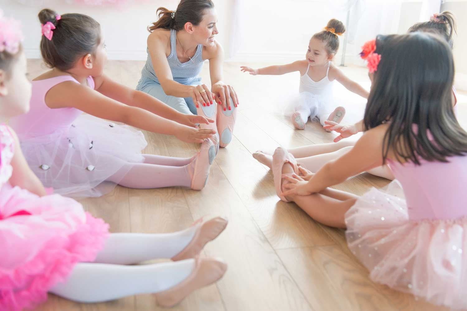 Stella stretching with her students | Stellar Dance Studio