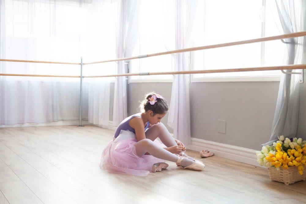 Stellar Dance Studio | Ballet dance tying her ballet shoes